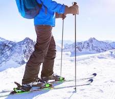 Skier with poles.